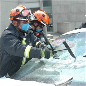 Firefighters Breaking Windshield